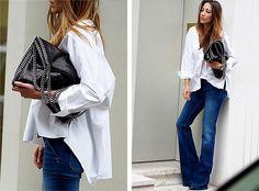 white mens button-down, flare denim, black heels, black slouchy bag