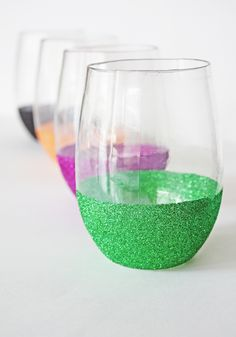 What you'll need: Plastic Stemless Wine Glasses Glitter Assortment Mod Podge Washi Tape or Painter's Tape Step 1: Apply the washi tape or painter's tape as