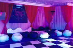 Four Seasons Park Lane London - Black and white dance floor, neon sign, wall drapes, lighting, bean bags and retro furniture by www.stressfreehire.com #venuetransformers