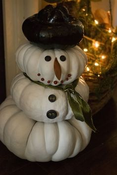 Turn your leftover pumpkins into snowmen!  GENIUS.