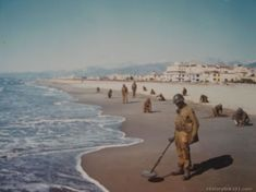 Engineers of the 92nd (Negro) Division tape cleared paths through the heavily mined beach at Viareggo, Italy. Germans, fearing invasion from...