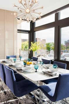 Homes with modern architecture often call for sleek decor. Make your dining room festive while remaining contemporary with pops of fun color on modern chairs or the walls.