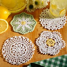 How does this garden of pretty flowers grow? With thread! Floral centers turn these coasters into dainty accessories with a purpose. You can stitch all four for variety or pick out your favorite and make a matching set. These designs are crocheted using bedspread weight cotton thread (size 10) and a size 6 (1.80 mm) steel crochet hook.