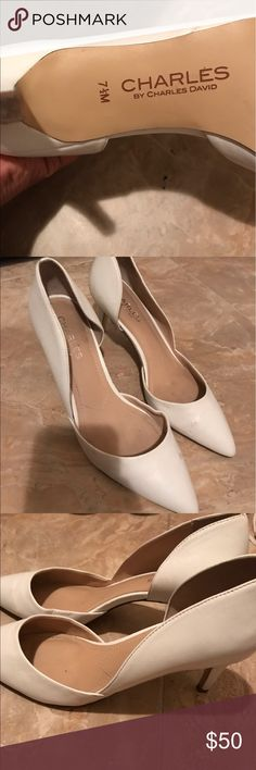 White Leather D'orsay Pumps Originally purchased at $100  These have been worn a couple times  Has a minor scratch on the bottom of both heels  Willing to negotiate on price just message me Charles David Shoes Heels