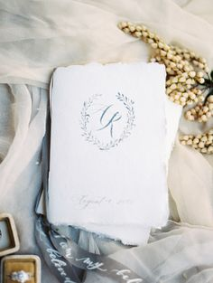 Thanks to Seniman Calligraphy, this program booklet's frayed edges and calligraphed monogram brought a vintage, Old-world element to a desert ceremony.