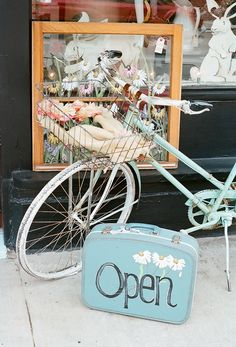 old suitcase sign only it will say welcome, maybe in French. My bike color fits our scheme well!