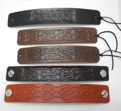 Handcarved and hand painted leather bracelets, celtic knot