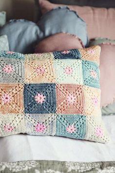 Semi-solid crochet granny squares.