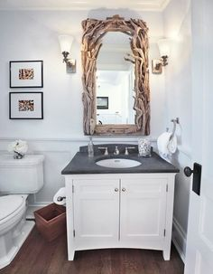 love the driftwood mirror!  Beach Style Powder Room by ADL III Architecture