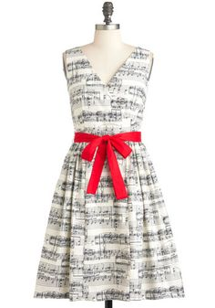 Sheet music dress!  Side note: Why do I feel like it takes courage to wear something like this?  I love this so much, but would be afraid to wear it... I'm nuts! :)