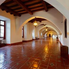 Textured, whitewashed walls, exposed ceiling beams and terra-cotta tile floors are hallmarks of Spanish-style homes.