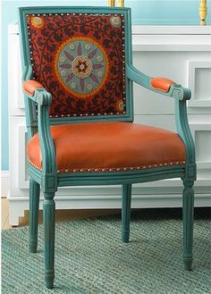 Bright painted chair with textile on back.