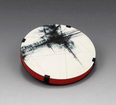 """Julia Turner """"Break"""" brooch, 2010. Steel, paint, wood. 2.6 x 2.6 x .4 in (6.5 x 6.5 x 1 cm)."""