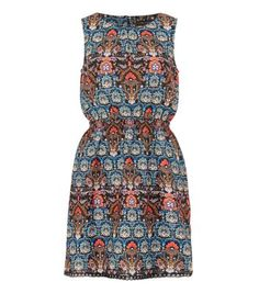Try out bold prints this season with this folk skater number. Tan boots are the perfect addition.- Simple sleeveless style- Cinched waist- Crochet hem- Woven fabric- Lightweight design- Dress length: 35