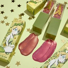 Sprinkle A Little Magic On Your Daily Makeup With This Tinker Bell Colourpop Collection! - beauty - Glitter Hair Spray, Disney Inspired Makeup, Daily Makeup, Fairy Wings, Lip Stain, Glossy Lips, Matte Gold, Shades Of Green, Makeup Inspiration