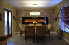 """Dining Room by Stylish Fireplaces & Interiors with 95"""" electric fireplace."""