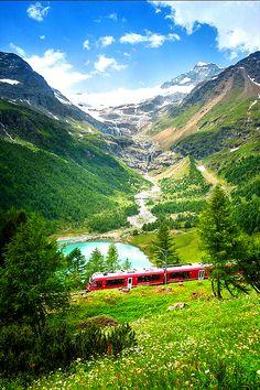 Burnina Express Passes Lago pallu in the Italian Alps on its Journey from Switzerland to the Italian town