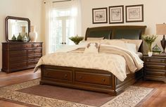 Burnished Cherry woods shine beautifully in this classically traditional sleigh bed. Two leather-like upholstered panels are fixed in the headboard and defined with a nail head trim. Thick panel-like bed rails feature with soft carvings adding luxurious drama from head to toe. Two oversized storage drawers glide on supportive metal tracks, while decorative knobs adorn front of drawer for a subtle concealed storage look.