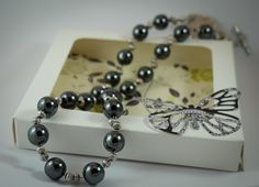 Necklace - Round Hematite beads with silver accents by ButterflyJade on Etsy https://www.etsy.com/listing/223735930/necklace-round-hematite-beads-with