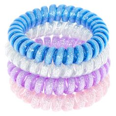 Tie your hair up with spiral hair ties in gorgeous galactic colors! Show off all the space vibes included in this four pack with silver, purple, pink, and blue. Glitter finish Spiral design Pack size: 4 Material: PlasticCan also be worn as a bracelet Coil Hair Ties, Elastic Hair Ties, Scrunchies, Cake Designs For Girl, Hair Rubber Bands, Hair Bands, Hair Tie Bracelet, Bracelets, Cat Ears Headband