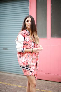 Anisa Sojka styles pink and orange blurred floral Finders Keepers optical illusion with a pinstripe neckline bomber jacket and dress from Harvey Nichols   White Zara strappy sandals   Multicoloured stackable Shashi hippie bracelets and rings   Fashion blogger street style shot in London by Cristiana Malcica