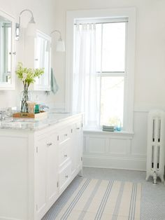 White Bathroom Design Ideas    Bypass the bold hues and embrace the clean, polished simplicity of white. Find out how to create a sparkling bathroom using white paint neutral hues.  By Taysha Murtaugh