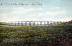 The Gassman Coulee Trestle in Trestle Valley spans 1792 feet. Aka the Great Northern Railroad bridge is a few miles outside of Minot, ND. Postcard circa 1900.