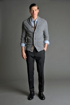 Pairing a grey shawl cardigan with black dress pants will create a powerful and confident silhouette. Dress down this getup with black leather derby shoes.  Shop this look for $114:  http://lookastic.com/men/looks/longsleeve-shirt-tie-shawl-cardigan-dress-pants-derby-shoes/5907  — Light Blue Long Sleeve Shirt  — Brown Tie  — Grey Shawl Cardigan  — Black Dress Pants  — Black Leather Derby Shoes