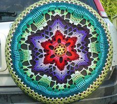 Ravelry: Starflower Mandala pattern by zelna olivier used as tire cover