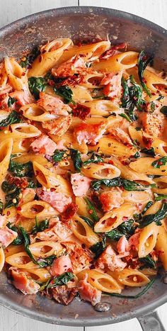 Salmon Pasta with Sun-Dried Tomato Cream Sauce and Spinach - quick and easy dinner made in 30 minutes! Pan-seared salmon is combined with the delicious penne in a flavorful, restaurant-quality cream sauce. Salmon is a Salmon Pasta Recipes, Creamy Salmon Pasta, Seared Salmon Recipes, Pan Seared Salmon, Baked Salmon, Shrimp Recipes, Fish Recipes, Creamy Chicken, Quiches