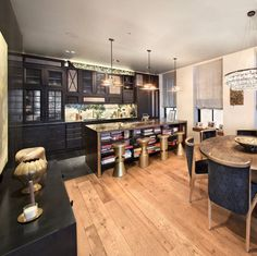 Pin for Later: John Legend and Chrissy Teigen Are Asking $4.5M For Their 1-Bedroom Apartment  Brass stools made a bold and modern statement in the kitchen.