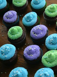 blue, green and purple cupcakes