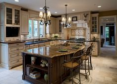 I like the #kitchen #island and the overhang for seating. I would only change a few things. Light fixtures, and the island is a little too fancy.