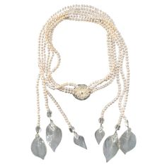 2003s CHANEL Tripple Pearl Strand Clear Camellia Flower And Leaves Necklace | From a unique collection of vintage multi-strand necklaces at https://www.1stdibs.com/jewelry/necklaces/multi-strand-necklaces/