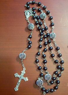 Rosary--looks like a cheap and easy one to make for yourself, too. The our father's are available at Michaels, the black most places, and the crucifix, links, and center just about any craft store.