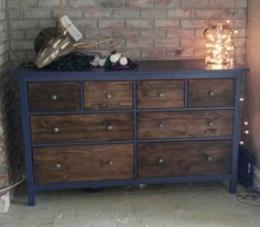 IKEA blue hemnes 8 drawer dresser hack. I sanded the face of the drawers until there was no more blue then stained with dark walnut another light sand and a coat of matte finish. I used a fine grit sand paper and sanded the original metal hardware to and a more rustic look