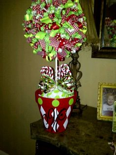 Easy to make Christmas Topiary.  All you need is a styrophone ball, dowel, ribbon, straight pins, flower pot and spray paint.  Great idea for any holiday decor!