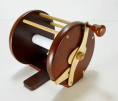 The Fishing Reel Toilet Paper Holder // 10 UNIQUE Toilet Paper Holder Designs That Will Transform Your Bathroom Forever
