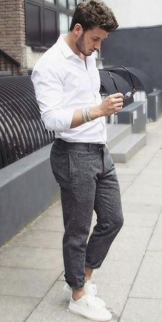 Alvaro Germany - with a summer business casual monochrome look with a white button up shirt with gray trousers wrist accessories no show socks white sneakers #summerstyle #summeroutfits #monochrome #menswear #menstyle #minimal #streetstyle #streetwear #whitesneakers #sunglasses
