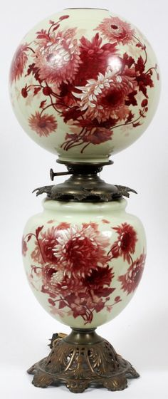 VICTORIAN GONE W/ THE WIND OIL LAMP 19TH CENTURY, HAND PAINTED FLORAL GLASS BASE AND GLASS GLOBE, BRASS FITTINGS