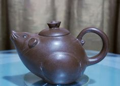 Emperors Antique (aka Naik Antiques and Oriental Gifts)  A Zisha Teapot in the Shape of a Rat. Suitable as a gift or decoration.