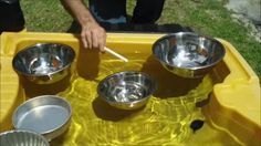 Combine water & music play - fill metal containers w different levels of water & strike them, or use a triangle or saucepan lids and see what happens when you strike them and then dip them into the water. The pitch moves by a whole tone. https://www.facebook.com/Juliewyliemusic