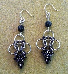 "Spiked Inverted Aura Earrings. Jotunheim: The Earrings. This is the last installment of the Jotunheim chain maille jewelry set. ""Spiked Inverted Aura"" using Bright Aluminum and Enameled Copper in Black and Gray and Snowflake Obsidian. These coordinate with the spiked necklace and bracelet that I have previously posted."