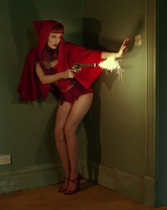 KAREN ELSON, RED CAPE & GUN,  BRENTFORD, UK, 2008  BRITISH VOGUE (reminds me of Red Riding Hood shooting the big bad wolf.)