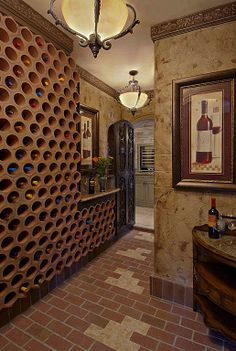 Uncork wine stored in this honeycomb-like cellar wall.