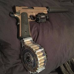 Sig Sauer 1911 emperor scorpion with a suppressor,laser/light,and 28 round drum - ©