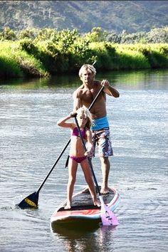 Laird Hamilton paddleboarding on Kauai