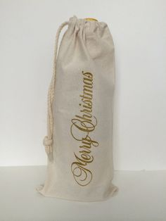 This reusable wine tote bag would make a fantastic Holiday gift! The wine tote is screen printed with the phrase Merry Christmas. It is shown here in Gold and is also available in red.