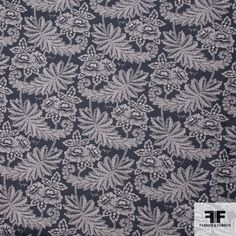 """This is elegant non-metallic brocade imported from Italy. It has a beautifully detailed woven leaf print around 7.5"""" wide. The cream color leaves with dark grey background created an antique classic look. This soft cotton has a medium drape and will lend itself to suits, jackets, and long to knee length skirt."""