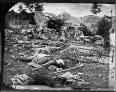Devil's Den, Gettysburg Battlefield.  One of the most haunted places. It's hard to believe that where most of these bodies are laying in this picture, is now a parking lot. Creepy and tragic.